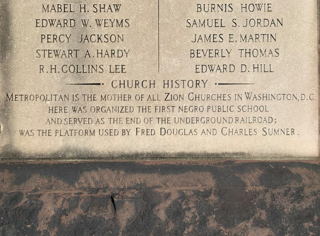 a close up of the plaque on the front of Metropolitan Wesley AME Zion Church