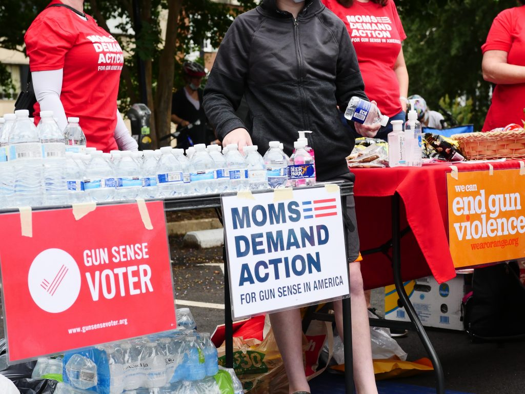 Members of MOMS Demand Action were at the bike rally supporting black students. They also provided water and other refreshments at the rally (Photo taken by Alex Lucas).