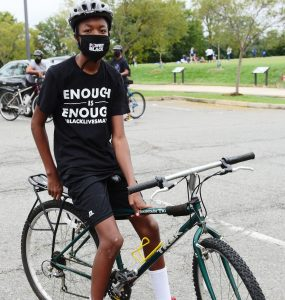 Zachariah Dawson is a 12-year-old Arlington student who joined a bike rally protest this past weekend. Dawson said he is doing his part in demanding at APS (Photo taken by Alex Lucas).