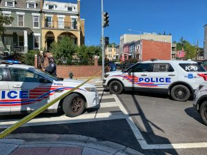 Police cars block entrance of Columbia Rd NW