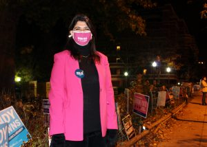 Brooke Pinto poses outside voting center