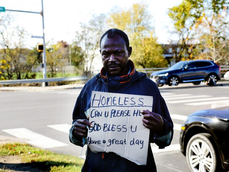 Moe Jackson stands at the intersection of Arlington Mills Road and Shirlington Road in the Arlington Nauck Community. According to Metropolitan Washington Council of Government's 2020 survey, Black residents represent 10% of the total Arlington population but 38% of the county's homeless population. (Alex Lucas / The Wash)